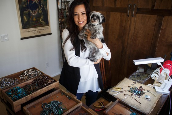Rosary designer Arasely Rios with her dog Luna in her Temecula studio. Rios is crafting a rosary for Pope Francis which he will receive upon his arrival to the U.S. on Sept. 22. Photo by Shane Gibson